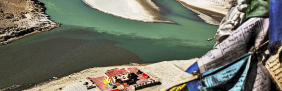 Tibetan plateau rivers with prayer flags