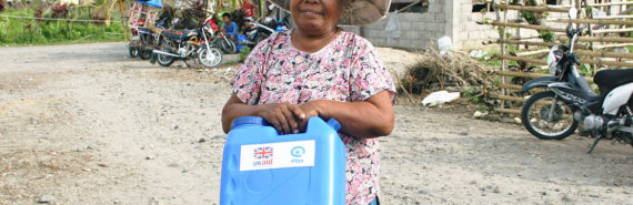 woman with a jerrycan after Typhoon Haiyan