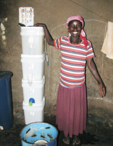 woman poses with foam water filter