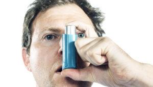 man uses inhaler