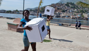 residents carry toilets