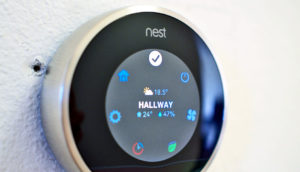 nest thermostat on wall