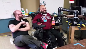man moves robotic arm with his mind