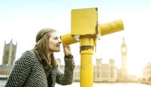 woman looks through binocular