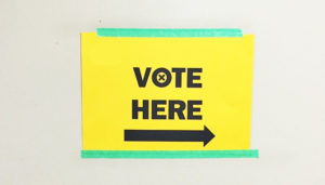 yellow vote here sign