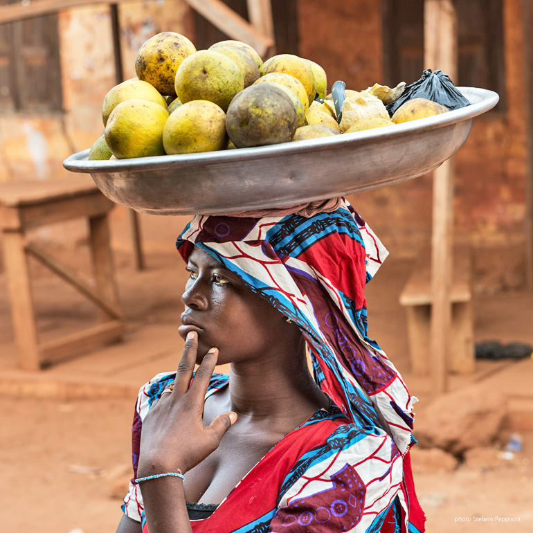 woman in ghana carries fruit