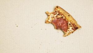 pizza scrap left in box