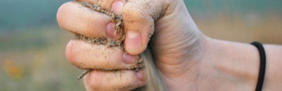 hand gripping sand