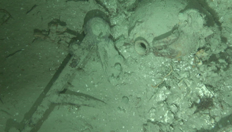 An octant or sextant and pottery jug from the wreck site