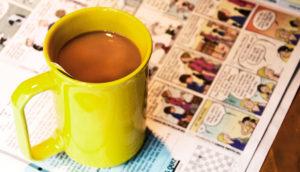 yellow mug and comics page