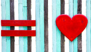 wooden red equal sign and red heart