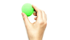 hand holds green ball - cell sorter