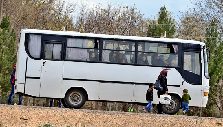 refugees in bus