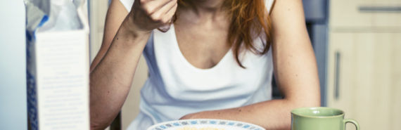 woman eats cereal