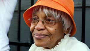 older woman wearing an orange hat