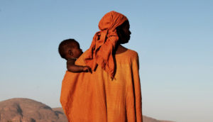 mom holds baby in Mali