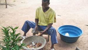man processes cassava