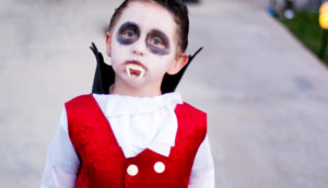 child in a Dracula costume