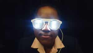 woman wears glasses that glow