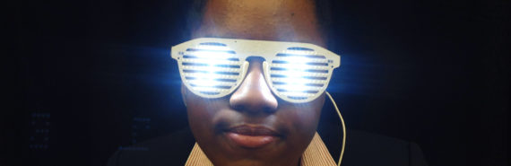 woman wears glasses that glow