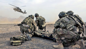 soldiers wait for medevac helicopter during a training exercise