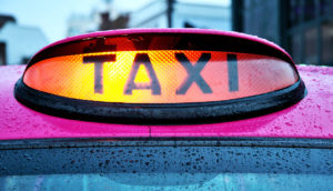 light on pink taxi cab