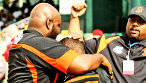 coach hugs football player