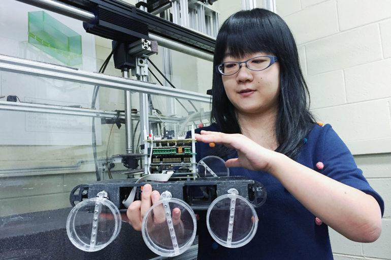 Graduate student Feifei Qian shows details of the Sandbot