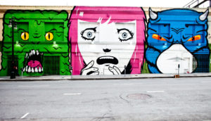 scary faces painted on buildings