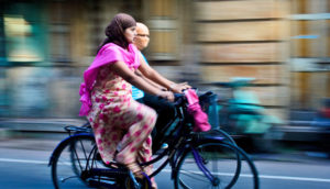 women in Puna, India ride bicycles