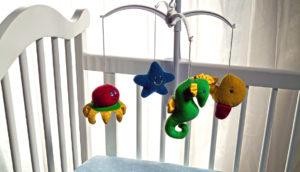 mobile hangs over crib