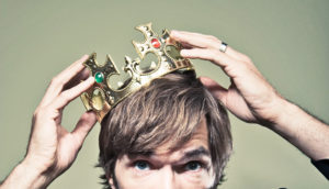 man puts on crown