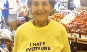 woman wears 'I hate everyone' sweatshirt