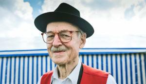 older man in a black hat