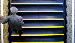 older man climbs stairs