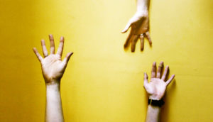 hand reaching on yellow - axons