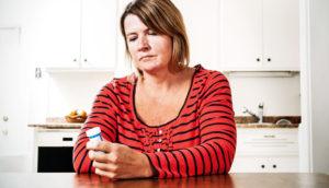 woman considers pills