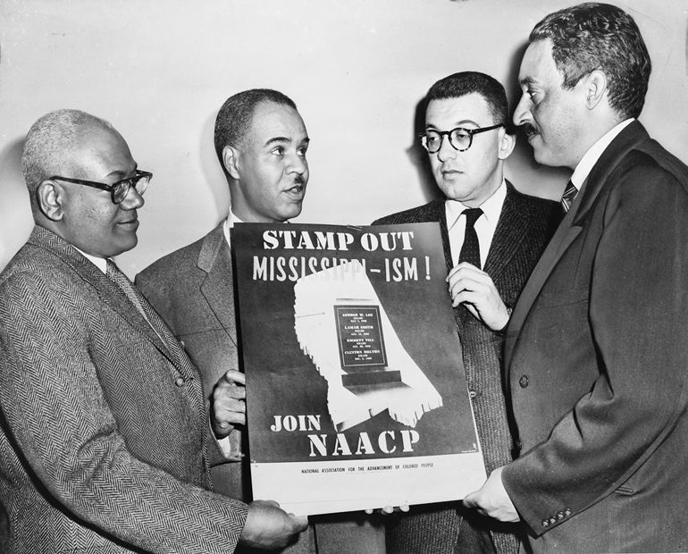 NAACP leaders with poster