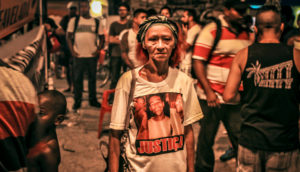 woman at protest in Rio favela