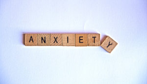 "scrabble letters spell ""anxiety"""