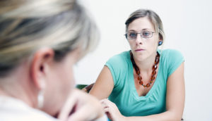 counselor talks with a patient