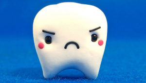 cute tooth on blue