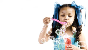 girl and bubble wand