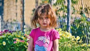 little girl in ice cream t-shirt