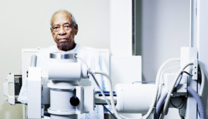 elderly man and x-ray machine