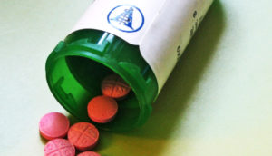 green bottle, pink pills