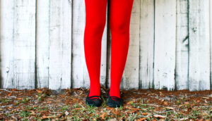 red tights, white fence