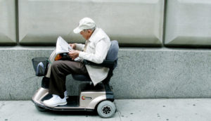 older man on a scooter