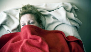 woman in bed with the flu