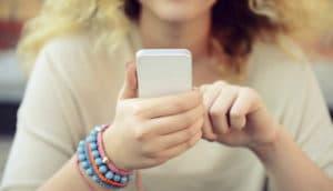 girl holds phone